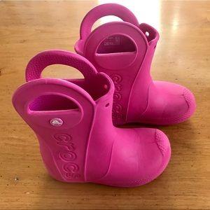 "GUC CROCS ""handle it"" rain boots in pink"
